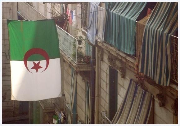 Downtown Algiers with huge Algerian flag